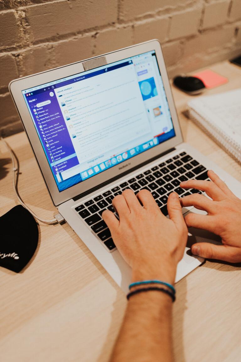 Craig, Web Developer, types on Macbook laptop