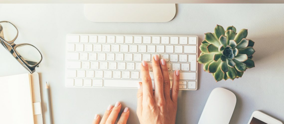 cozy-workplace-for-successful-work-elegant-female-hands-on-the-keyboard-of-computer-in-the-office-or_t20_gR3O8N