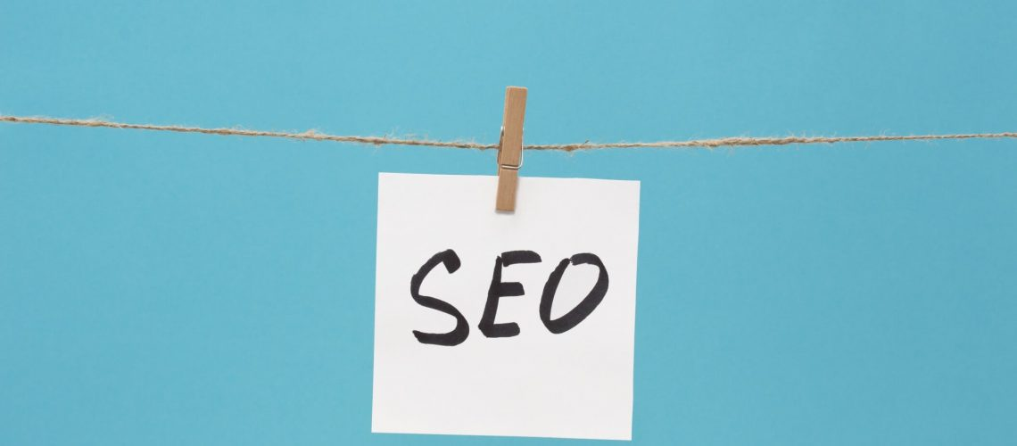 seo-the-note-is-written-on-a-white-sticker-that-hangs-with-a-clothespin-on-a-rope-on-a-blue-colored_t20_AVOaJV 2